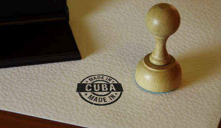 Made in Cuba stamp and stamping hand. Factory, manufacturing and production country concept.