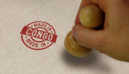 Made in Congo stamp and stamping hand. Factory, manufacturing and production country concept.