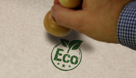 Eco friendly stamp and stamping hand. Ecology, environment and climate concept. Stok Fotoğraf