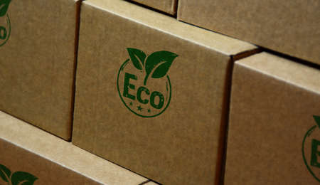 Eco friendly stamp printed on cardboard box. Ecology, environment and climate concept. Stok Fotoğraf