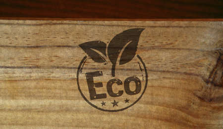 Eco friendly stamp printed on wooden box. Ecology, environment and climate concept.