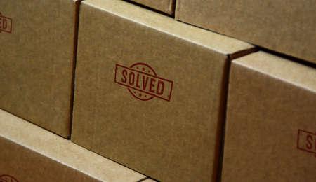 Solved stamp printed on cardboard box. Problem solution concept.