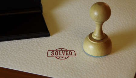 Solved stamp and stamping hand. Problem solution concept. Stok Fotoğraf