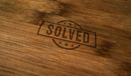 Solved stamp printed on wooden box. Problem solution concept.