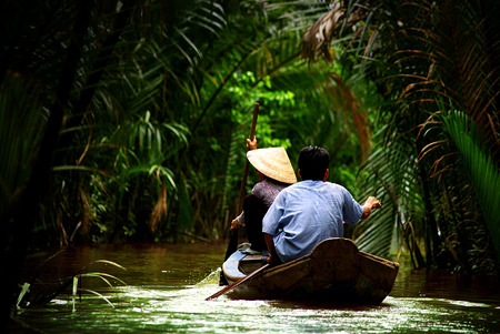 pointy hat: on the Mekong river