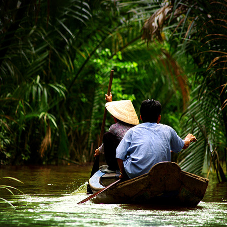 pointy hat: on Mekong river