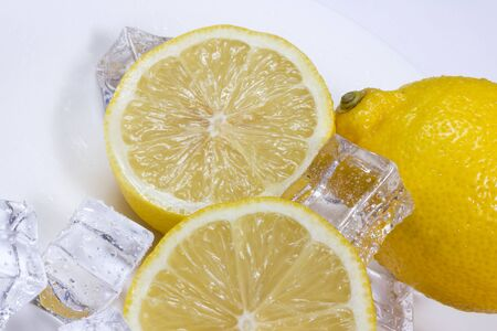 Lemon with ice cubes in a bowl.