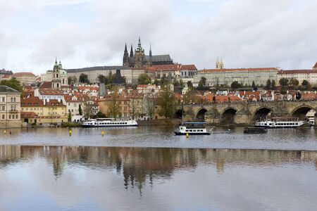 The Charles Bridge in Prague and the river Vltava on an autumn day.