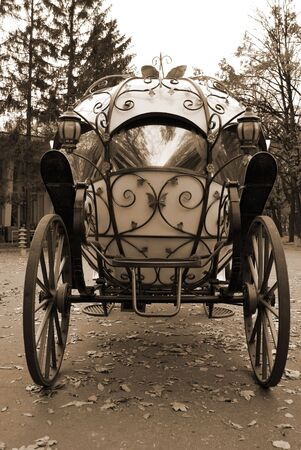 Fairy Tale Forged Carriage With Big Metal Wheels, Beautiful Decor And Mirror Glass Windows photo