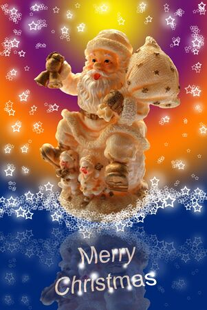 Merry Christmas Greeting Card with Santa Claus Toy Statuette, Lacy Starry Snowflakes and Multicolored Background photo