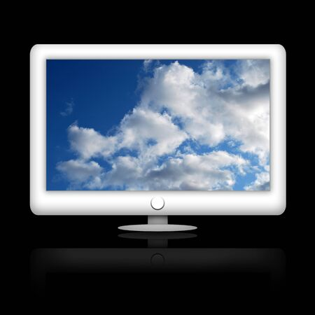 White modern TV or computer monitor with cloudy blue sky on wide screen  photo