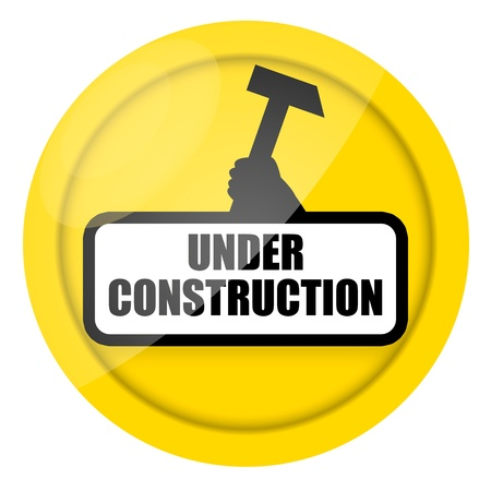 Under construction sign with raised up the   arm of worker holding hammer in hand  isolated over white background Stock Photo