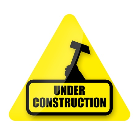 Under construction sign isolated over white background photo