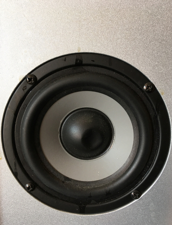 Broken audio loud speaker background Stock Photo