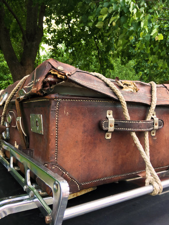 Vintage suitcase, tied with a rope