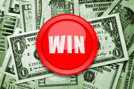 Win money concept with american dollars and red button