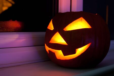 Halloween pumpkin with scary face on the window at night Stock Photo - 15794484