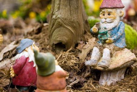 Zittend tuinkabouters Stockfoto