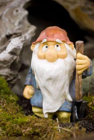 midget: Garden gnome with shovel Stock Photo