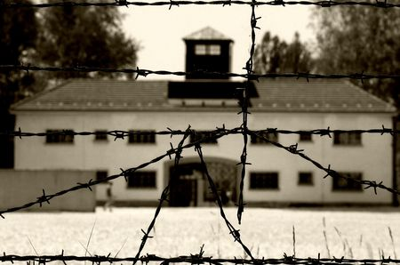 concentration camp: Dachau concentration camp through barbed wire