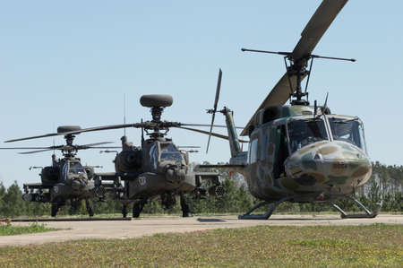 us air force: A set of three Apache helicopters sit on the helipad