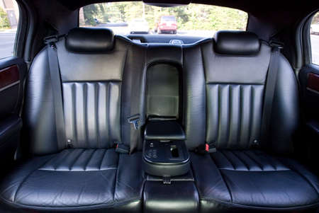 A pair of seats in the back of a limo 版權商用圖片