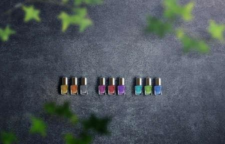 Colorful background photo of fashionable nail polish