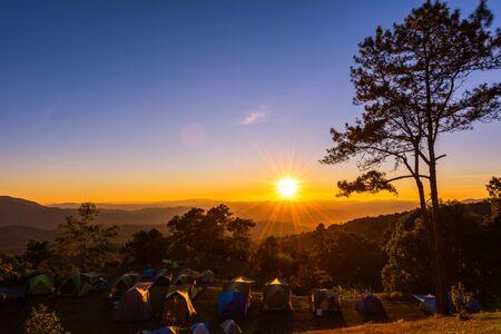 Sunset view with camping tents at Huai Nam Dang National Park, Chiang mai, Thailand 版權商用圖片