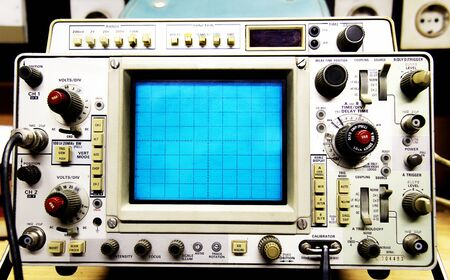 vintage oscilloscope in electrician setting