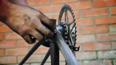 sanding old bicycle frame