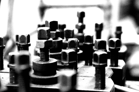dirty artistic vintage grunge nuts and bolts in black and white Stock Photo