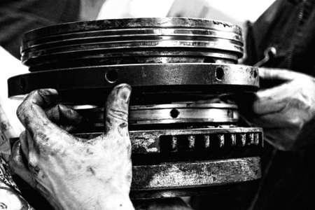 dirty hands - mechanics at work  -engine  dissassembling - halftone