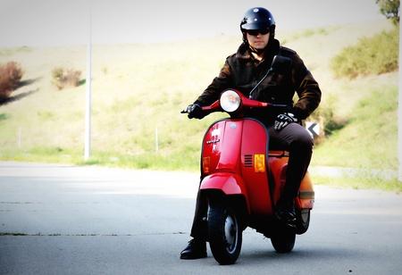 portrait of a red vespa rider in autumn