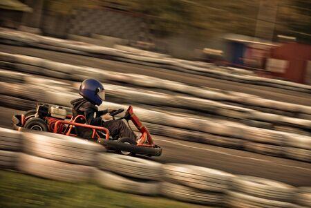 go kart: go kart racing on circuit (Blurry!)