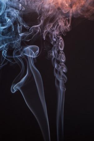 arson: Beautiful smoke on the black background - macro photo.
