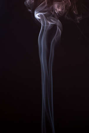 ember: Beautiful smoke on the black background - macro photo.