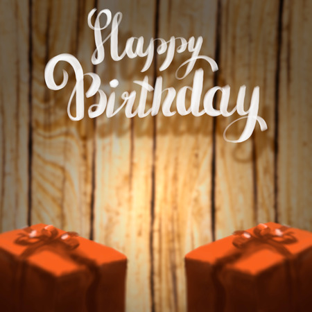 Happy Birthday lettering illustration with two gift boxes ribbon wrapped on the wooden blurred background.