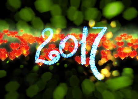 date night: Happy new year 2017 isolated numbers written with light on dark bokeh background and red flying hearts 3d illustration.