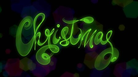 Christmas word lettering written with green fire flame or smoke on blurred bokeh background. Stock Photo