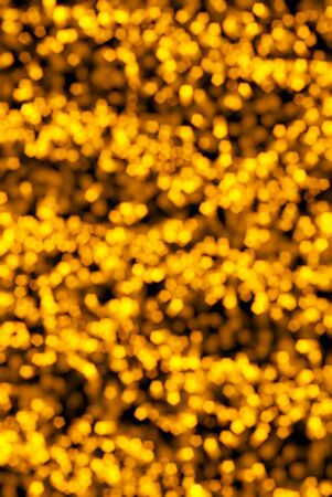 abstract and festive gold bokeh background, blurred lights Stock Photo