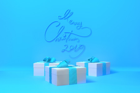 Merry Christmas 2019 lettering written on blue color wall and three present gift boxes with bows beside. 3d illustration Stock Photo