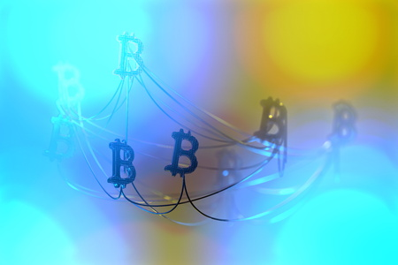 Golden bitcoin signs flying in the air and connected to each other by wire network. Cryptocurrency concept. 3d illustration 写真素材