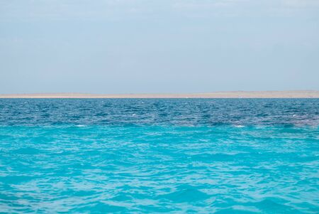 Wide shot of a beautiful clear turquoise sea ocean water surface with low ripples and subtle waves on seascape background, horizontal picture. Vacation travel background with copyspace for your text Stok Fotoğraf