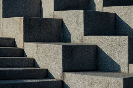 Abstract stairs, steps made of granite, often seen on monuments and landmarks,diagonal lit by bright sun light Banque d'images - 133063128