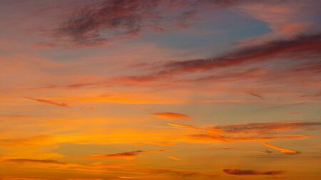 Evening sunset sky with bright rays of the sun and beautiful colorful clouds Stock Photo - 138432630