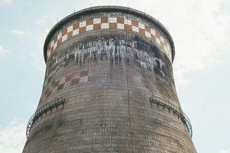 incredibly huge, old, industrial chimney made of concrete blocks. Concept of preserving the environment and taking care of nature