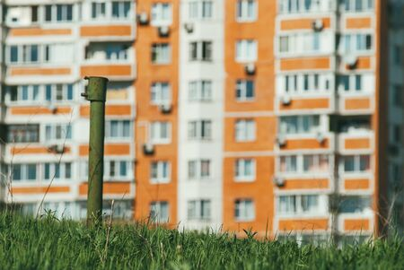 modern new, multi-family residential building with green grass in the foreground. the concept of new life and moving. Selective focus macro shot with shallow DOF Banco de Imagens