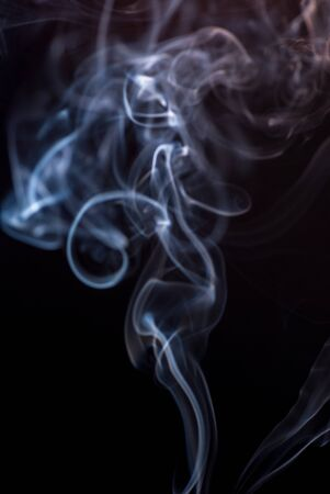 Beautiful smoke on the black background - macro photo. The concept of incense in the apartment. Isolated on black background overlay for your needs. Defocused blurred image Banco de Imagens