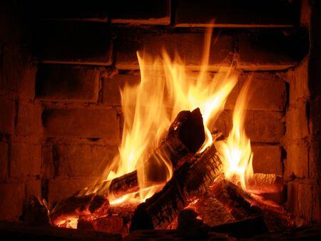 fireside: Fire in a fireplace Stock Photo