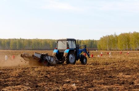 wheatfield: Tractor Plowing Wheatfield Stock Photo